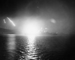 USS Saint Paul bombarding communist positions at night near Hungnam, South Hamgyong Province, Korea, Dec 1950