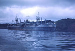 USS Sanborn (APA-193) in harbor at dawn or dusk, circa late-1944 or 1945, photo 1 of 4