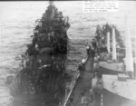 USS San Diego assisting USS Haggard after the latter was hit by Japanese special attack, off Okinawa, Japan, 29 Apr 1945