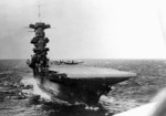 View of USS Saratoga from a TBD-1 Devastator aircraft which had just taken off from the flight deck, circa summer 1941