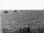 British Eastern Fleet destroyers providing honorary escort to USS Saratoga (foreground) as the US carrier departed Indian Ocean, 18 May 1944