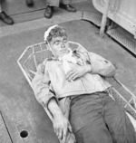 US Navy airmen Alva Parker, wounded during a raid on Rabaul in New Britain, aboard USS Saratoga awaiting medical treatment, 5 Nov 1943