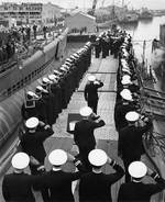 The National Ensign raised aboard submarine Skate, 15 Apr 1943; Seahorse at left & Sargo at right