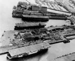 USS Shamrock Bay (bottom of photograph) with two other escort carriers, Astoria, Oregon, United States, 6 Apr 1944; photo taken by an aircraft from USS Shipley Bay
