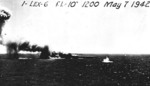 Shoho burning as she was attacked by aircraft, Battle of Coral Sea, 7 May 1942; note TBD-1 Devastator torpedo bomber faintly visible to the right of splash