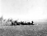 Shoho burning during Battle of Coral Sea, photographed by a torpedo bomber pilot from Yorktown, 7 May 1942; note the faint outline of a TBD-1 in bottom half of photo