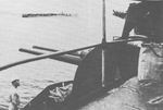 View of an anti-aircraft gun aboard Japanese carrier Shokaku, date unknown; the carrier in background was likely Zuikaku