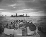 View of SS G. Harrison Smith from the stern of United States Coast Guard cutter Spencer, North Atlantic, 500 nautical miles WSW of Ireland, 17 Apr 1943