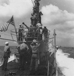 Sailors on and around the conning tower aboard USS Spot, 1944-1945