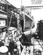 Launching of submarine Spot, Mare Island Naval Shipyard, Vallejo, California, United States, 19 May 1944; note Mrs. Tisdale, RAdm E L Cochrane, Mrs. Gieselmann, RAdm M S Tisdale, Jean Gieselmann, Capt A O Gieselmann, Mrs. Klein, Capt G C Klein