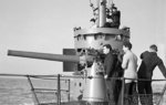 Crew of HMS Sunfish practice on the 76-mm (3-in) deck gun while skipper Lt. Hilary John Bartlett watched, Portsmouth, Hampshire, England, UK, 4 Nov 1943