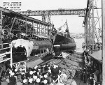 Launching of Trigger, Mare Island Navy Yard, Vallejo, California, United States, 22 Oct 1941; note submarine Sunfish and submarine tender Sperry in background