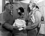 Captain Dixie Kiefer of USS Ticonderoga presenting VT-80 pilot Clyde Grow a cake for making the 6,000th landing of the carrier (