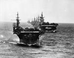 US Navy Task Group 38.3 entering Ulithi anchorage in a column following strikes in Philippine Islands, 24 Dec 1944, photo 2 of 7