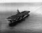 Carrier Ticonderoga off San Diego, California, United States, 16 Sep 1944; note extra aircraft loaded on deck destined for Hawaii, and camouflage pattern Measure 33 Design 10a. Photo 1 of 2.