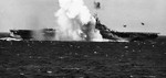 A Japanese special attack A6M aircraft crashing close aboard the starboard side of the carrier Ticonderoga off the Philippines, 5 Nov 1944. Photo 3 of 3.