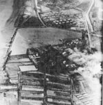 Kaneka Soda Company chemical plant under attack by Air Group 80 aircraft from USS Ticonderoga, Tainan, Taiwan, 15 Jan 1945, photo 2 of 2