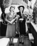 Mrs. Davenport and Mrs. Garvey at the christening of submarine Trepang, Mare Island Naval Shipyard, California, United States, 23 Mar 1944