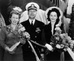 Commander Roy Davenport with his wife (with bottle) and Mrs. Garvey at the christening of submarine Trepang, Mare Island Naval Shipyard, California, United States, 23 Mar 1944