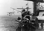 Tuscaloosa hoisting a SOC Seagull floatplane from the sea, while en route to Iceland, Sep 1941; note another SOC aircraft on starboard catapult