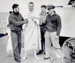 Crew of USS Spencer cared for rescued U-175 sailors, North Atlantic, 500 nautical miles WSW of Ireland, 17 Apr 1943, photo 1 of 2