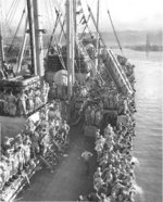 Returning Japanese-American troops lining up at the rails of Victory Ship SS Waterbury Victory, Honolulu, US Territory of Hawaii, 9 Aug 1946