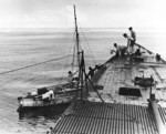 USS Wahoo providing food and water to crew of a becalmed fishing boat, circa Jan 1943; three fishermen had already died before being discovered by Wahoo