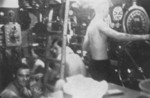 Men working in the control room aboard USS Wahoo, 27 Jan 1943 while at 300 feet during a depth charge attack by a Japanese destroyer. They had taken 6 depth charges and were awaiting more.