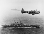 SBD-5 Dauntless aircraft flying over USS Washington and USS Lexington in the Pacific Ocean en route toward the Gilbert Islands, 12 Nov 1943