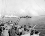 USS Cony laying smoke screen near USS West Virginia, off Leyte