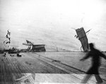 Catwalk on the port side of Yorktown bent as a result of torpedo damage, 4 Jun 1942