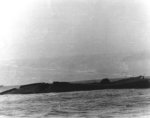 Yorktown sinking, showing starboard bilge above the water, 7 Jun 1942
