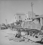 Dismantled French AMC 35 S medium tank, Porto Farina, Tunisia, May 1943; two more AMC 35 S tanks and a Valentine Mk III tank in background