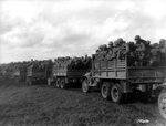 Convoy of CCKW 2 1/2-ton troop transports, date unknown