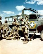 US Paratroopers of the 82nd Airborne preparing for a jump, North Africa, late 1942; note CCKW 2 1/2-ton 6x6 transport truck