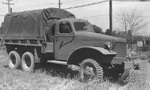 Front view of an International Harvester M-5H-6 2 1/2-ton 6x6 transport truck with 12-ft. bed, built to the same specifications as the GMC CCKW but in much fewer numbers; Holabird, Mayland, United States, date unknown