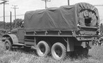 Rear view of an International Harvester M-5H-6 2 1/2-ton 6x6 transport truck with 12-ft. bed, built to the same specifications as the GMC CCKW but in much fewer numbers; Holabird, Mayland, United States, date unknown