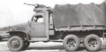 Early GMC CCKW 2 1/2-ton 6x6 closed cab short wheel base transport with winch and optional gun ring, date unknown