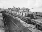 Cruiser Mk V Covenanter III tanks of British 9th Armoured Division being loaded onto flatbed railway wagons, Blaydon near Newcastle, England, United Kingdom, 17 Oct 1941