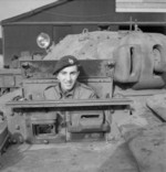 Trooper Bill Jones of the British Royal Tank Regiment in the driving seat of a Covenanter tank in Britain, 16 Feb 1942