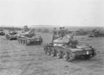 Prime Minister Winston Churchill and Major-General Brian Horrocks aboard a Covenanter tank of 4th/7th Royal Dragoon Guards, British 27th Armoured Brigade near Newmarket, Suffolk, England, United Kingdom, 16 May 1942; note H. V. Evatt in second tank