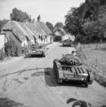 Covenanter tanks passing through the village of Stockton in Wiltshire, England, United Kingdom, 7 Aug 1942