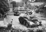 Cruiser Mk IV tanks of 5th Royal Tank Regiment of 3rd Armoured Brigade of British 1st Armoured Division in a village in Surrey County, England, United Kingdom, Jul 1940, photo 2 of 2