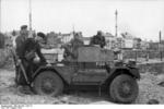 German troops inspecting a British Daimler Scout Car captured during the failed raid on Dieppe, France, late Aug 1942