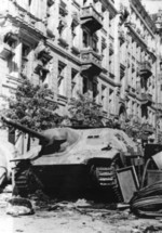 Polish barricade at Napoleon Square, Warsaw, Poland, 3 Aug 1944, photo 2 of 4; note captured Jagdpanzer 38(t) tank destroyer as part of barricade