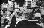 Polish barricade at Napoleon Square, Warsaw, Poland, 3 Aug 1944, photo 4 of 4; note captured Jagdpanzer 38(t) tank destroyer as part of barricade