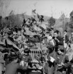 Chinese children celebrating on top of a Jeep, circa 1945; the occasion was either the opening of Ledo Road or victory over Japan