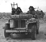 A close-up of a British heavily armed patrol of L Detachment SAS in their jeeps, just back from a three month patrol, 18 Jan 1943; note twin-mounted Vickers K machine guns; photo 3 of 3