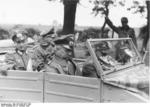 Field Marshal Walter Model and Colonel Wilk traveling in a Kübelwagen to visit the 246th Volksgrenadier Division in Aachen, Germany, 9 Oct 1944