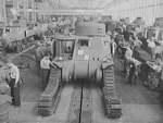 Workers putting tracks onto a M3 tank at the Detroit Arsenal Tank Plant, Warren, Michigan, United States, circa 1940-1942, photo 1 of 2